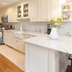 white quartz countertops sitting on white cabinets